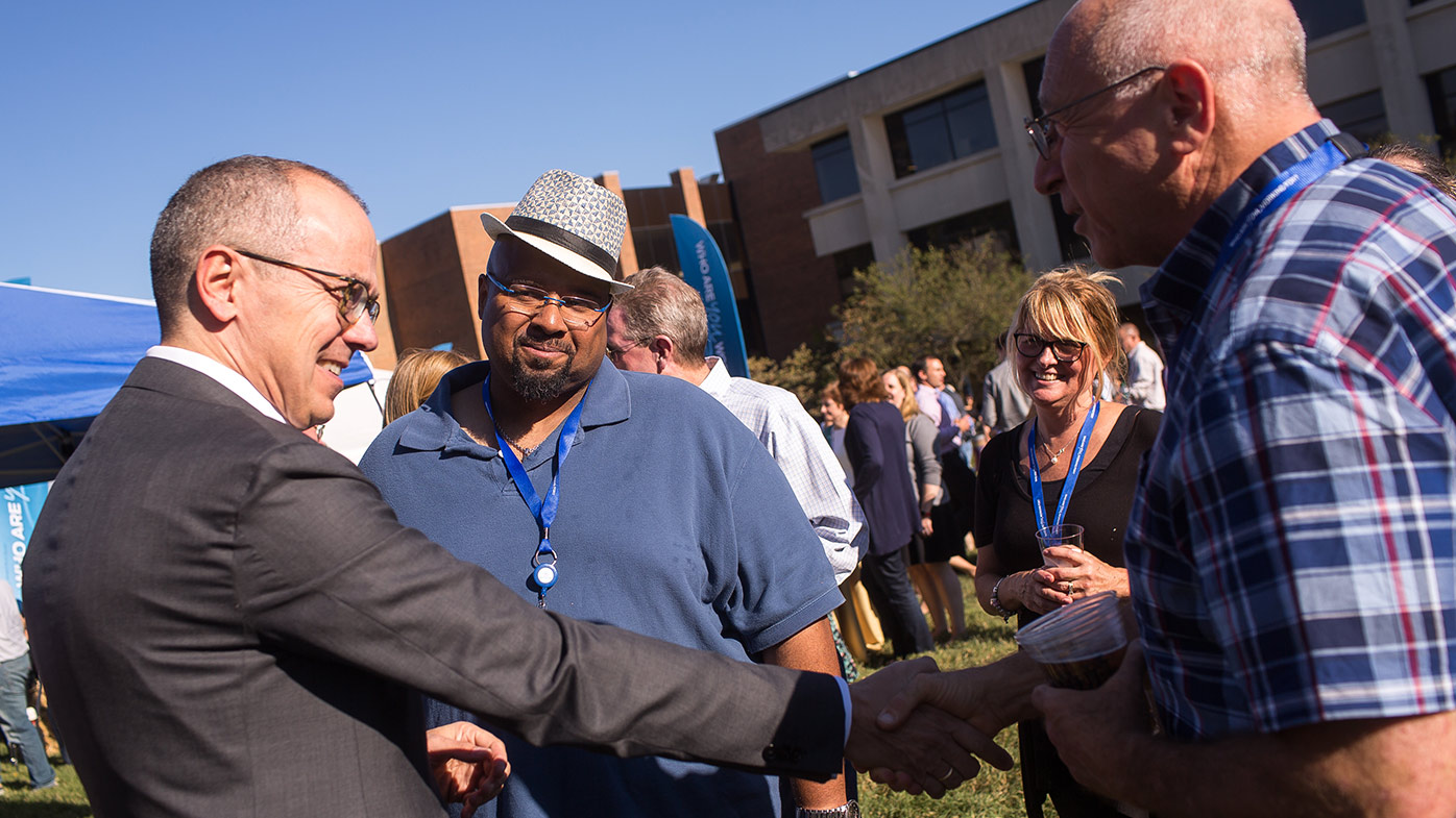 Patients share a moment with CEO Giovanni Caforio during a past Global Patient Week employee celebration in New Jersey.