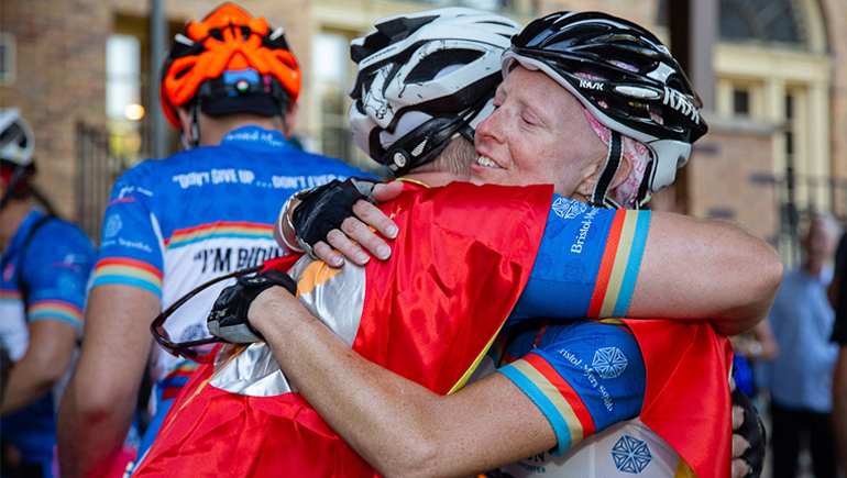 Heidi Googe celebrates with a fellow rider during the Coast 2 Coast 4 Cancer ride.