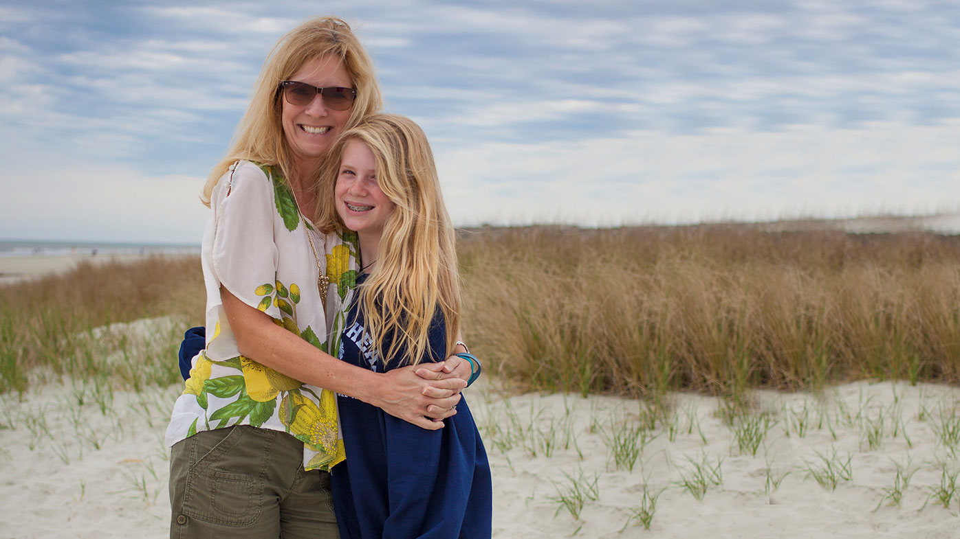 Anne-Marie Sotire, Head of Human Resources, Research & Development, enjoying downtime at the beach with her daughter.