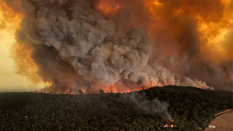 Fires rage under plumes of smoke in Bairnsdale, Australia, in this Dec. 30, 2019, photo from the Associated Press.