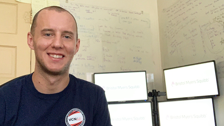 U.S. Army veteran Ryan McGinnis, a cybersecurity intern, created his own virtual workspace in his bedroom in New Brunswick, New Jersey.