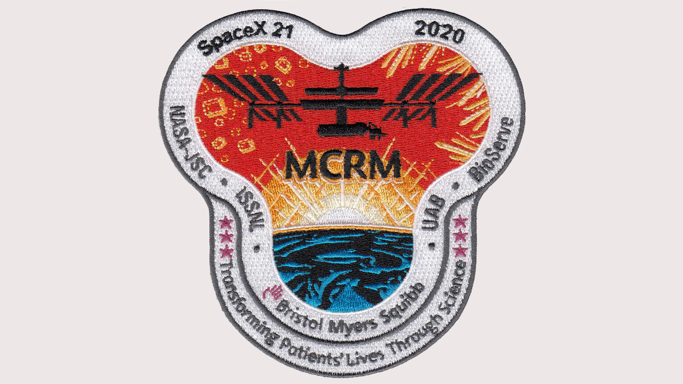 A patch Bristol Myers Squibb developed with the International Space Station Research Lab commemorates the mission. The letters MCRM refer to Monoclonal Crystal Research in Microgravity.