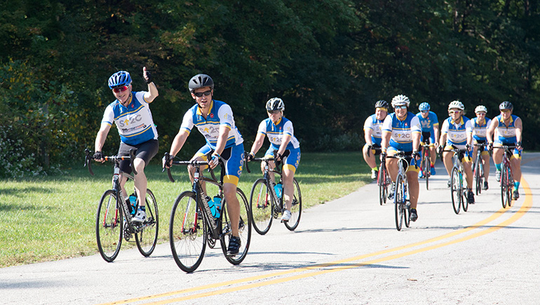Chief Scientific Officer, Tom Lynch, leads group of cyclists during ride